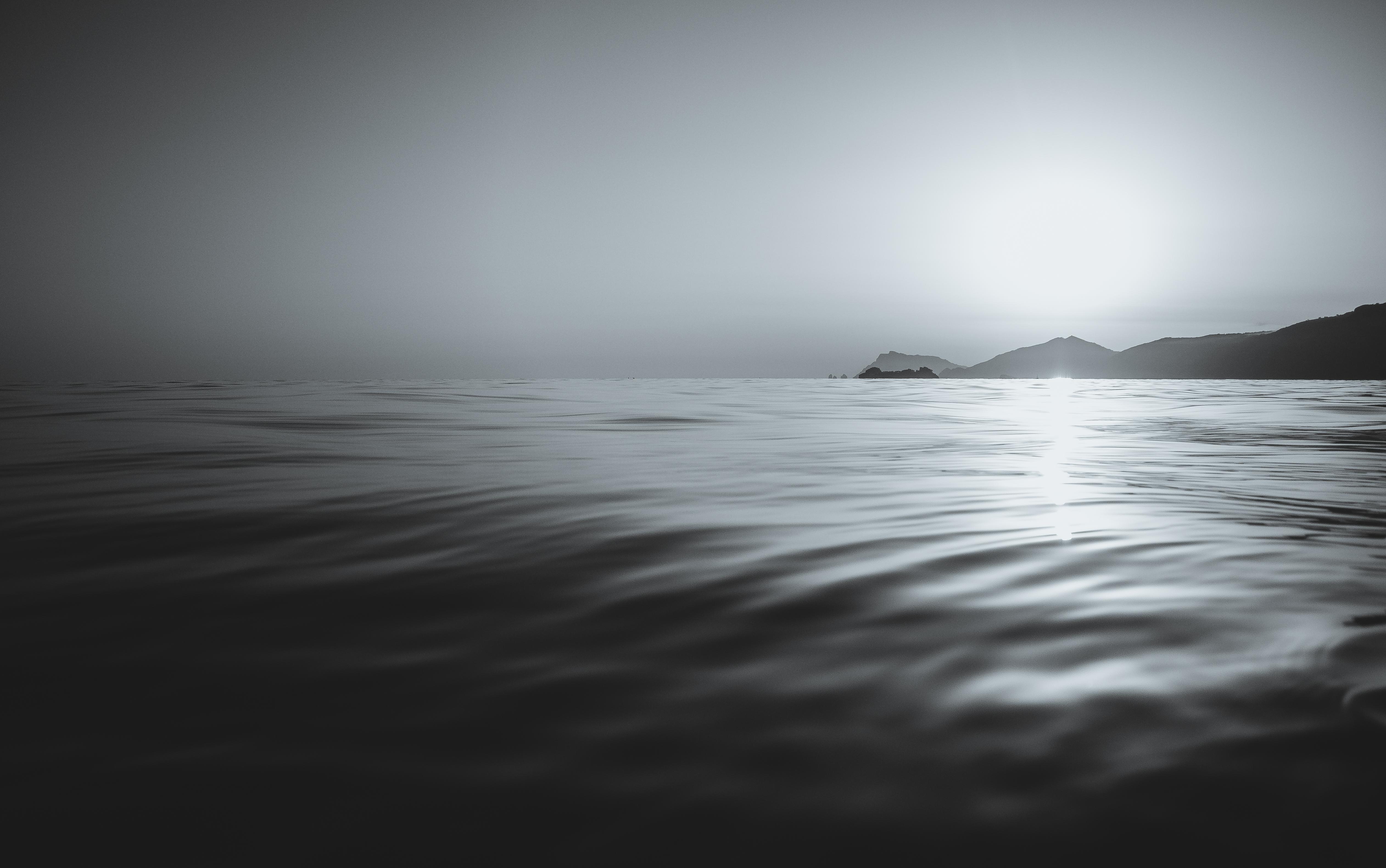 Black And White Calm Coast Islands Sea Sunset Waves 4k Wallpaper