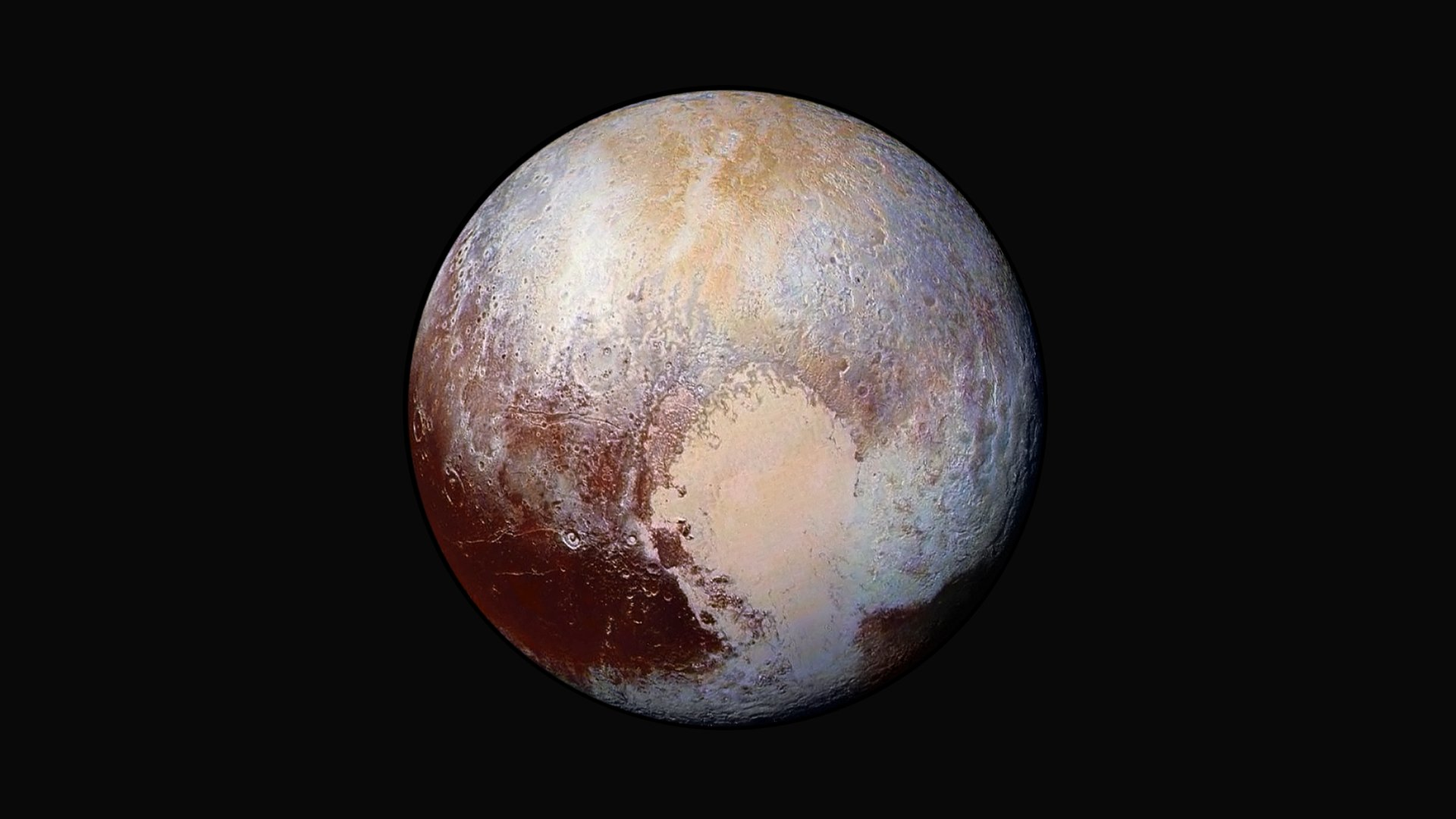 Enhanced Color Image of Pluto Used Detect Differences in the Composition and Texture wallpaper