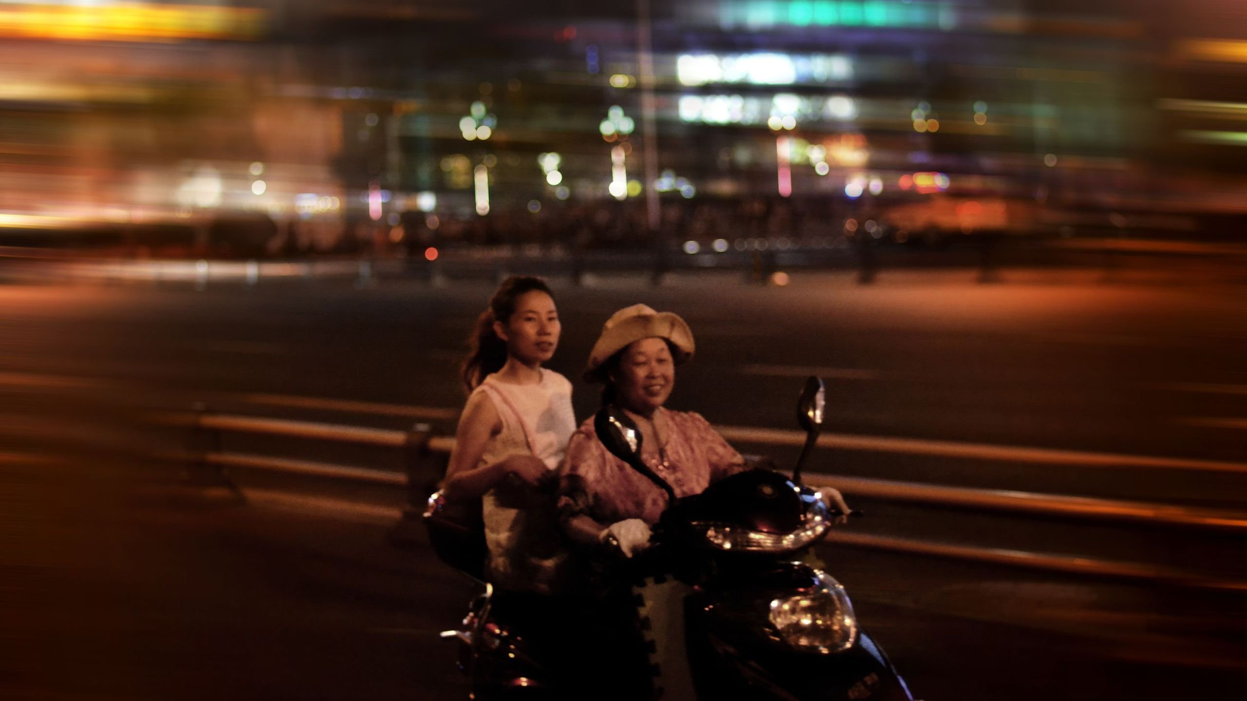 Women on Motorbikes in Chengdu China wallpaper
