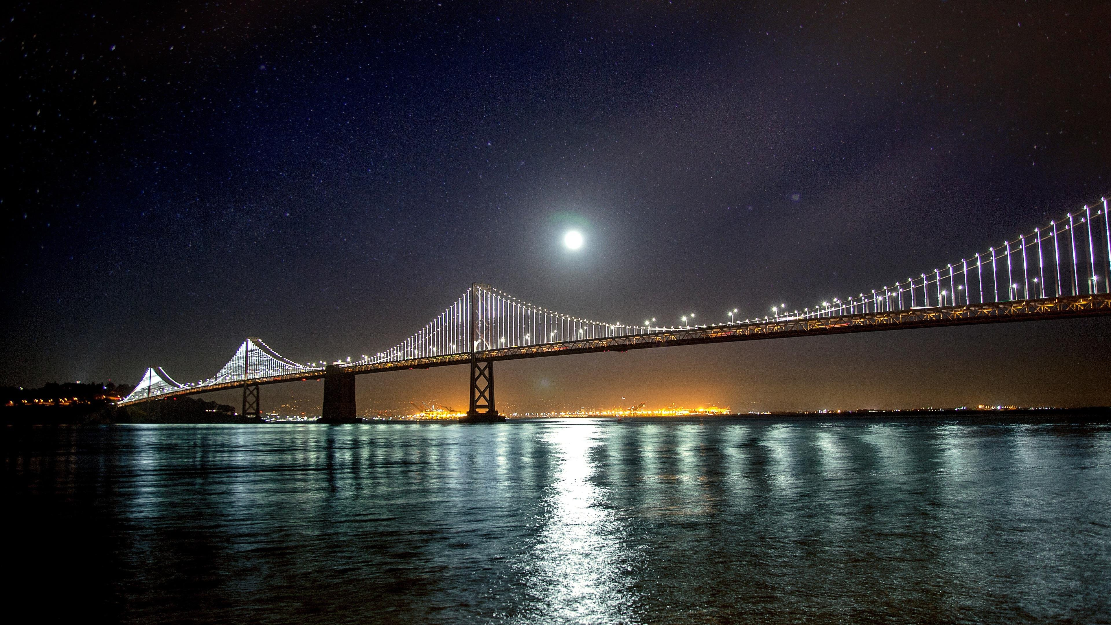 Night Bridge in the Lights Stars and Moon wallpaper