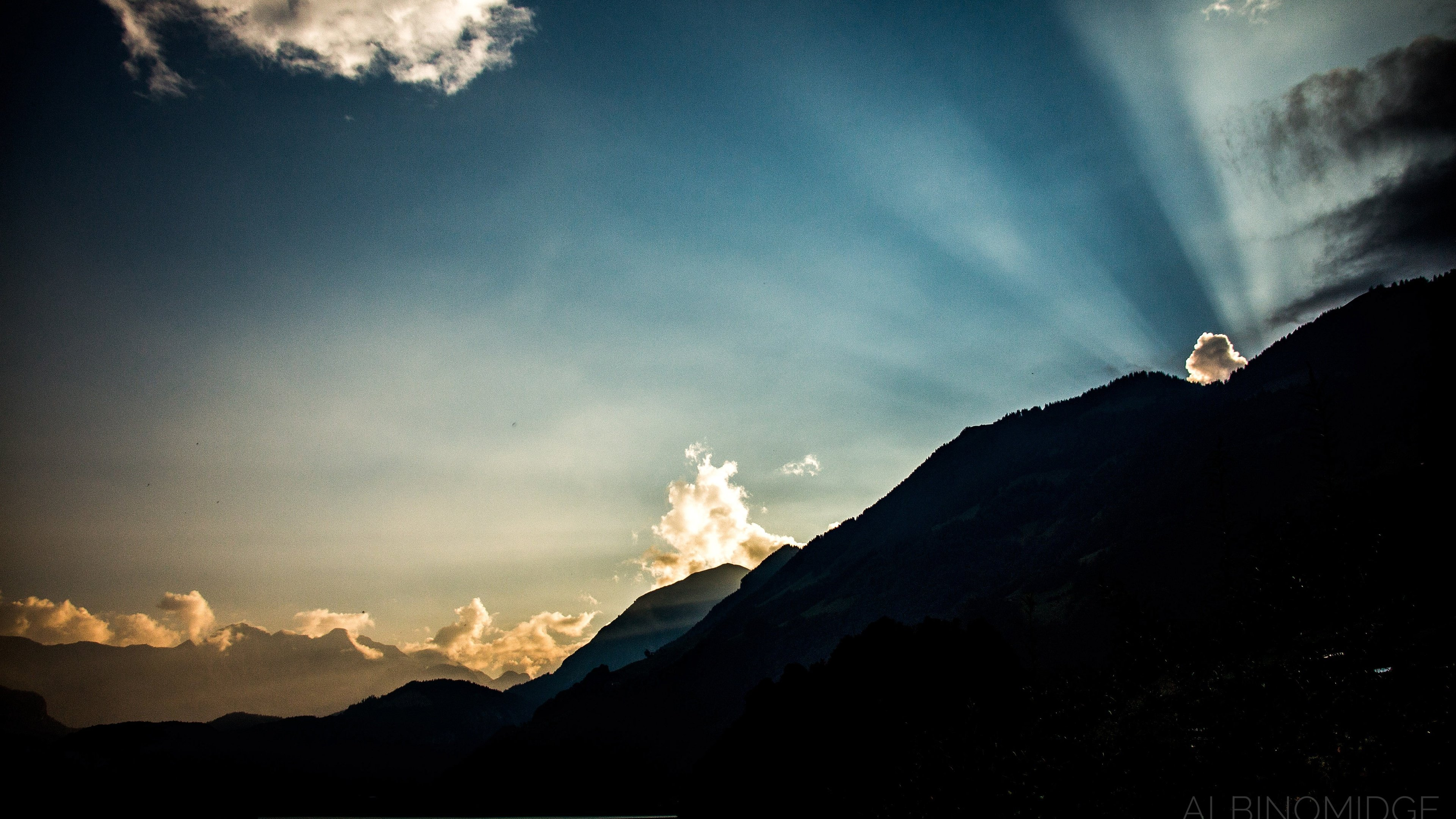 Sunrays Breaking Over the Mountains of Switzerland wallpaper