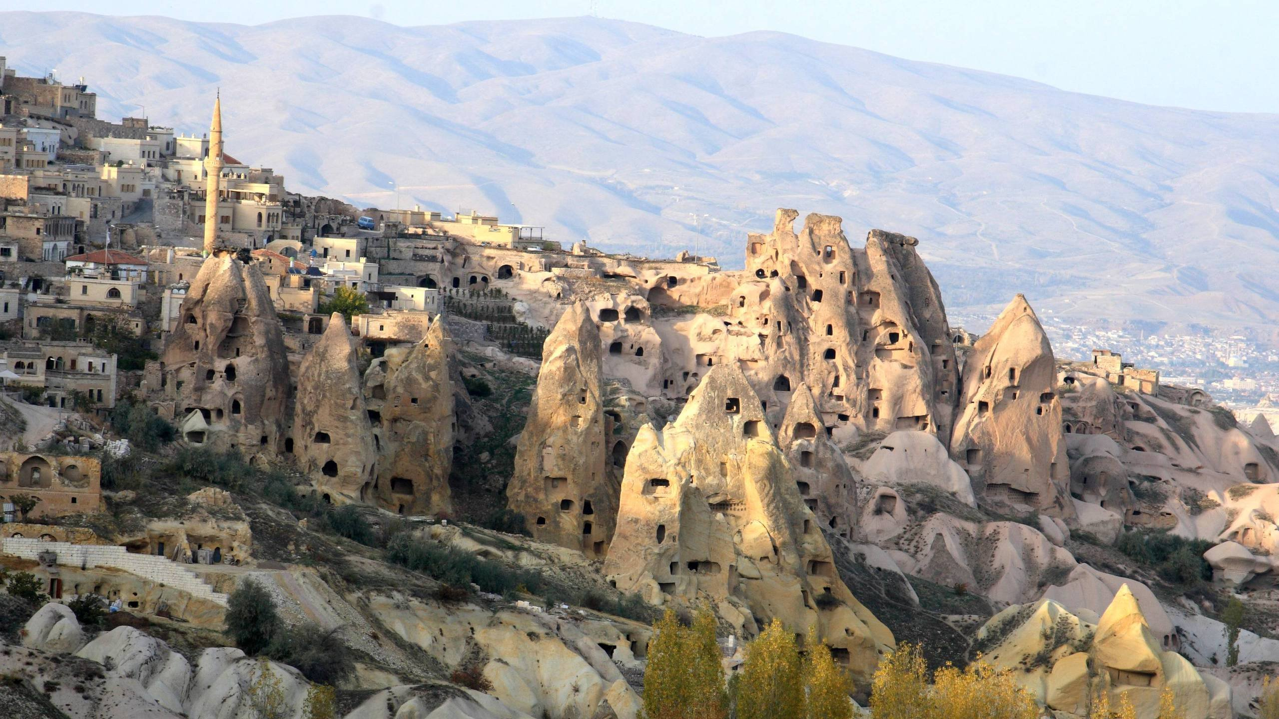 Ancient Rk Houses Intermingled With Modern In Cappadia Turkey Wallpaper