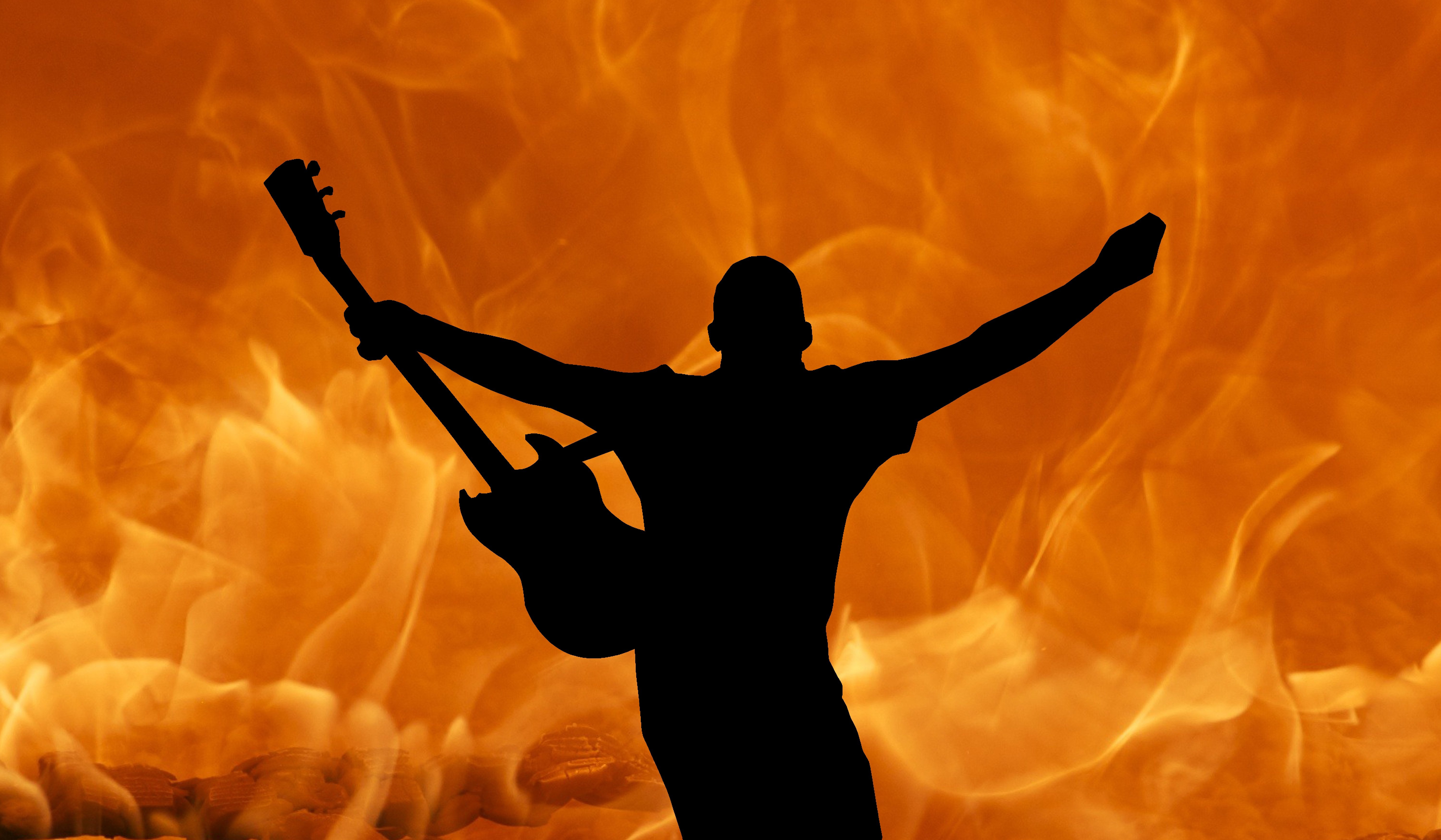 Brings the Fire on Stage With His Guitar wallpaper