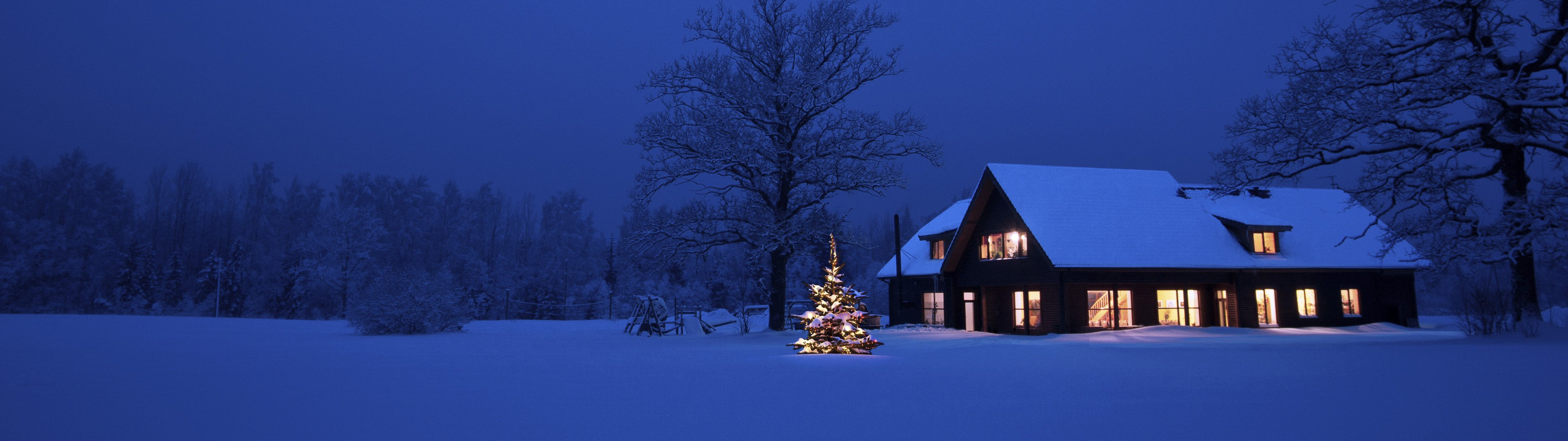 christmas tree and cozy house with snow outside for dual 1920x1080 wallpaper
