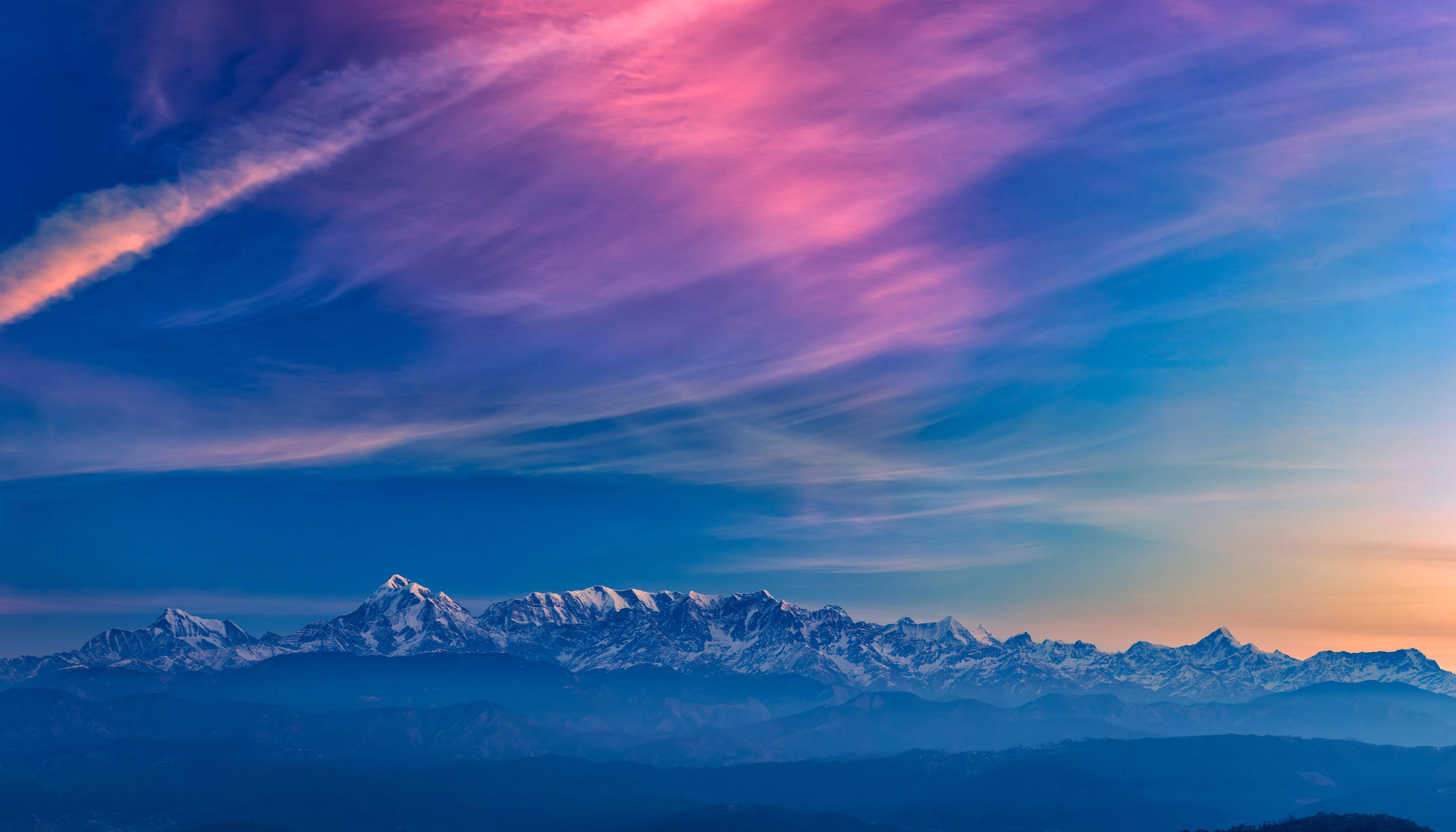 mountains pink blue white wallpaper