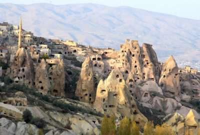 Ancient Rk Houses Intermingled With Modern Houses in Cappadia Turkey wallpaper