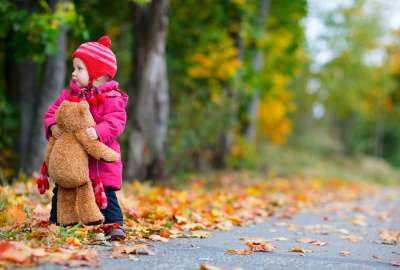 Kid on Autumn Leaves wallpaper