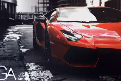 Orange Lamborghini With Rain Drops wallpaper