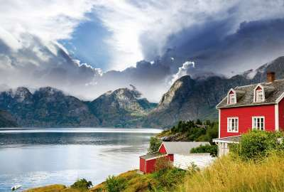 Red House Landscape Beside Water and Mountain wallpaper