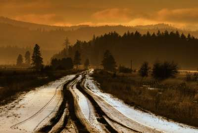Snow Road Heading into Mountains wallpaper