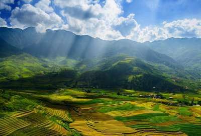 Sunlight Trough Clouds on Green Landscape wallpaper